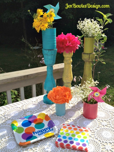 Rainbow sweet 16 party table flower decorations with plates and napkins