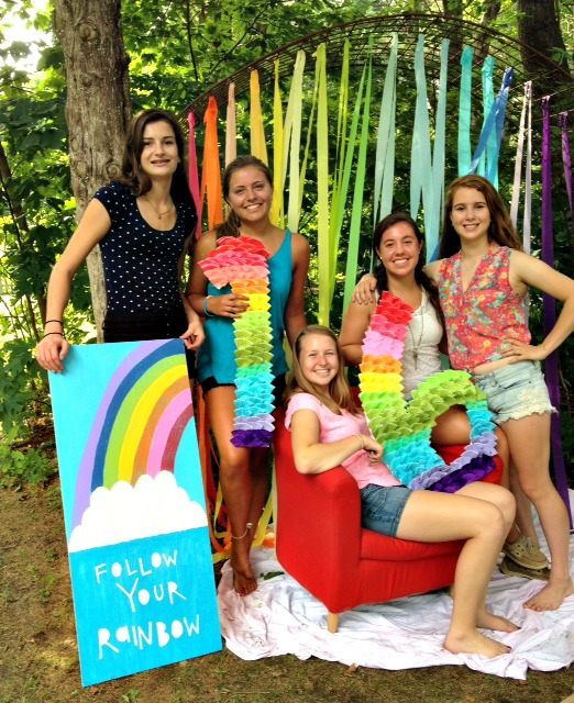 Group shot with rainbow