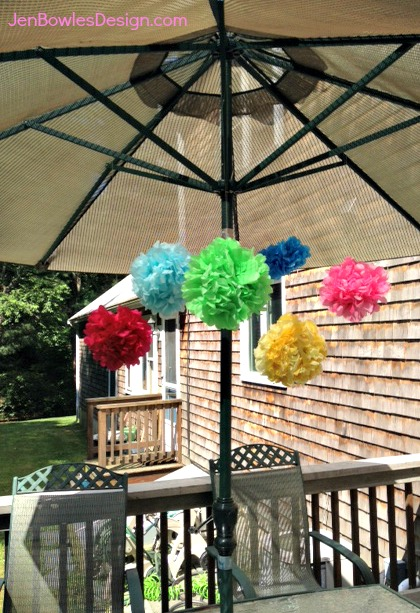 Tissue Pom Poms Hanging from Umbrella