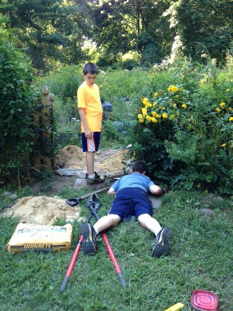 Rustic arbor digging holes